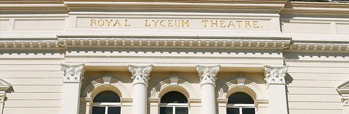 Work at The Lyceum: an image of the front of the theatre building with the sunshine hitting the gold lettering on the facade.