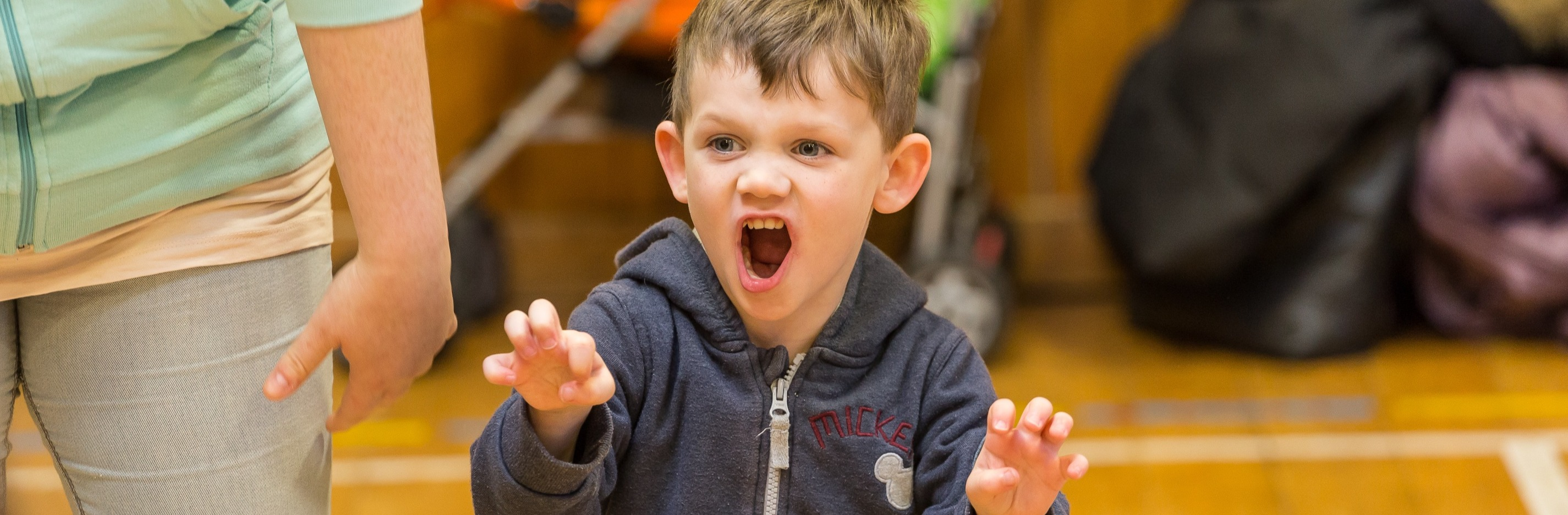A small child plays at being a lion in one of The Lyceum's schools workshops