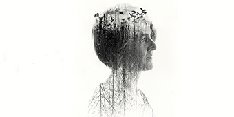 An image of Karine Polwart double-exposed to show trees, birds and evoke nature