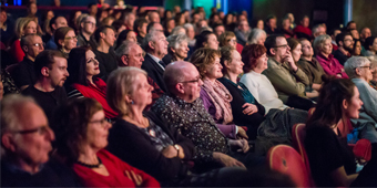 An image of happy audiences in the Stalls