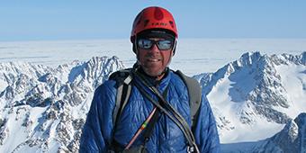 Simon standing on top of a mountain range