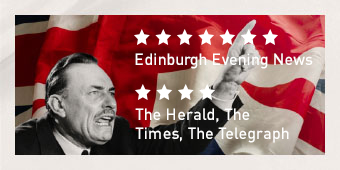 Politician Enoch Powell making a speech in front of the Union Jack of Great Britain