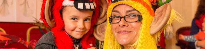 A mother and her son smile at the camera whilst dressed up in silly monster costumes from The Lyceum prop store