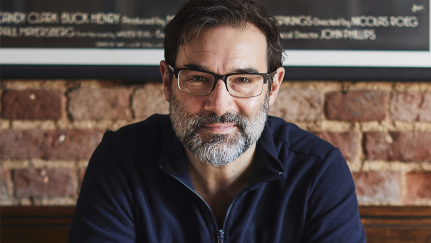 Portrait shot of Adam Buxton smiling to camera