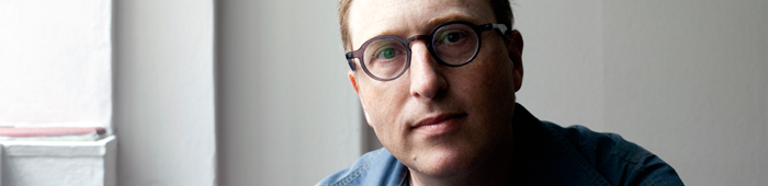 Image of Jon Ronson looking directly into camera
