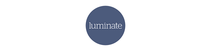 Luminate logo, a blue circle with the word 'Luminate' in white text in the centre