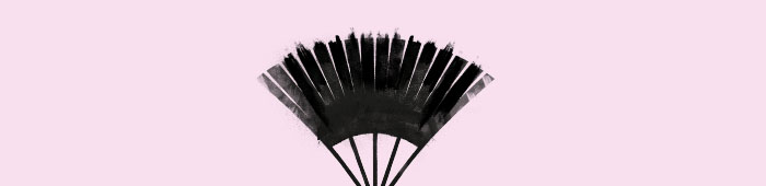 An oriental fan on a pink background